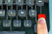 Keyboard of the old typewriter with a finger — Stock Photo