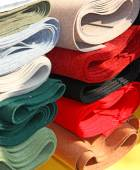 Robust Italian manufacture fabrics for sale in haberdashery — Stock Photo