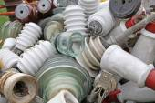 Old ceramic insulators in an old dump obsolete material — Stock Photo