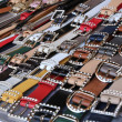Many men's leather belts and shoes for sale — Stock Photo #58333253
