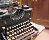 Black rusty typewriter with round keys — Stok fotoğraf