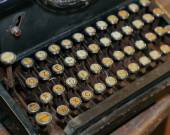 Retro black rusty typewriter with white keys — Stock Photo