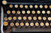 Ancient black rusty typewriter with white keys — Foto Stock