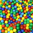 Lots of blue green red yellow colored spheres into a pool of bal — Stock Photo #59338479