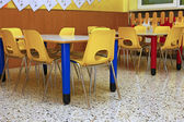 Yellow chairs and benches of a school for young children — Stock Photo
