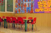Small red chairs and benches of a school for young children — Stock Photo