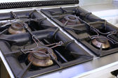Gas stove in an industrial kitchen in the school canteen — Stockfoto