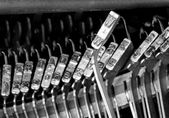 W hammers for writing with an ancient manual typewriter — Stock Photo