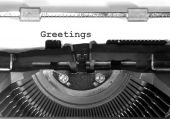 Typewriter Types Greetings Closeup — Stock Photo