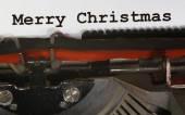 Old Typewriter Types MERRY CHRISTMAS  Closeup with black ink — Zdjęcie stockowe