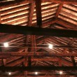 The roof with beams facing bricks and halogen lamps — Stock Photo #60542759