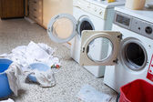 Two washing machines with the dirty laundry of the kindergarten — Stockfoto