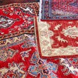 Asian rugs for sale in the shop of fabrics and textiles — Stock Photo #61791051