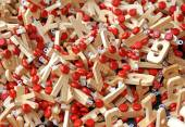 Letters in wood with Red wheels to compose words and name of chi — Stock Photo