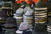 Felt hats of all sizes for sale at flea market — Stock Photo