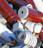 Electrical insulators and old fuses in a landfill — Stock Photo