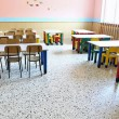 Постер, плакат: Large refectory of kindergarten with small tables and chairs