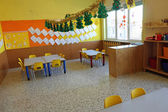 Kindergarten classroom with chairs and table — Foto de Stock