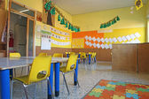 Preschool classroom with chairs and table — Stock Photo