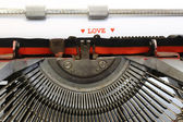 Written LOVE with red ink — Stock Photo