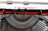 Italian written typewriter Saint Valentine and red hearts — Stock Photo