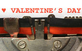 Written with the typewriter Valentines Day in red ink — Stock Photo