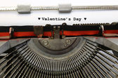 Written typewriter Valentine's Day with hearts — Stock Photo