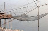 Fishing nets over the Stilt houses — Стоковое фото