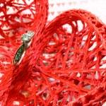 Big diamond engagement ring and many hearts — Stock Photo #63060943