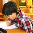 Boy does homework at his home — Stock Photo #63287613