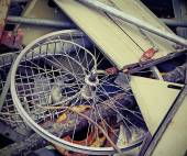 Wheel of a bike in the container — Stock Photo