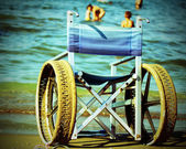 Wheelchair with perforated wheels — Stock Photo