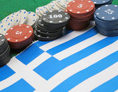 Tokens for gambling over the flag of Greece — Stock Photo
