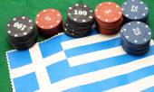Chips for gambling over the flag of Greece — Stock Photo