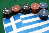 Casino tokens for gambling over the flag of Greece — Stock Photo