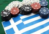Chips tokens for gambling over the flag of Greece — Stock Photo