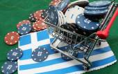 Shopping cart full of casino checks over the flag of Greece to g — Stock Photo