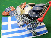 Shopping cart full of casino chips over the flag of Greece to ga — Stock Photo