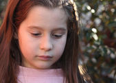 Portrait of seven year old girl outdoors — Stock Photo