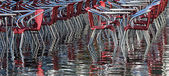 Venice Italy, water and red chairs — Stock Photo