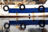 Three pneumatic wheels on fishing to protect the hull — Stock Photo