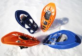 Four modern snowshoes in the mountain — Stock Photo