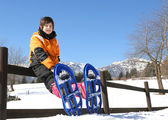 Child with snowshoes in the mountains — Foto de Stock