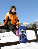 Child with blue snowshoes in the mountains — Foto de Stock
