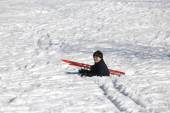 Child falls from skiing in winter — Stock Photo