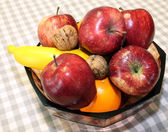Ripe red apples and fruit in the basket — Stockfoto