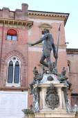 Fountain with nude statue of Neptune and the old palace — Stock Photo