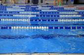 Indoor swimming pool with blue water — Stockfoto