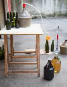 Wine bottling in the backyard with the Carboy — Stock Photo