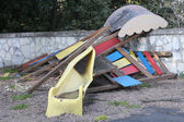 Slide broken and abandoned in a deserted playground after the di — Stock Photo